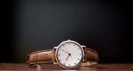 golden wristlet watch on table Stock Photo