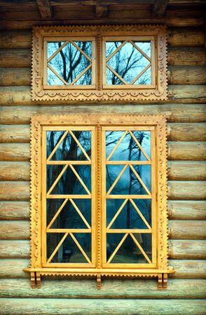 wooden window on the log wall  Standard-Bild