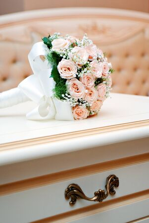 wedding beige bouquet from rose on the table