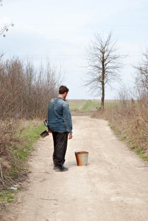 one man water-carrier stand on the road Stock Photo