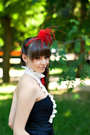 beautiful young girl with red cap in park Stock Photo