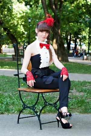 beautiful girl seat at the chair Standard-Bild