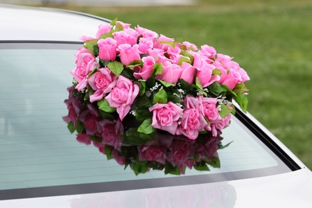 Beautiful red wedding bouquet on the car. Stock Photo - 10374209