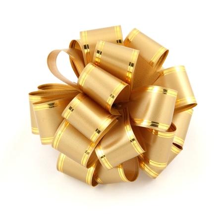 fiocco oro: prua oro su sfondo bianco Archivio Fotografico