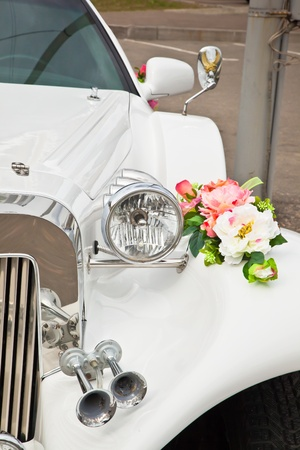 Beautiful wedding flowers on the car. photo