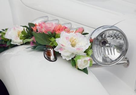 Beautiful wedding flowers on the car.