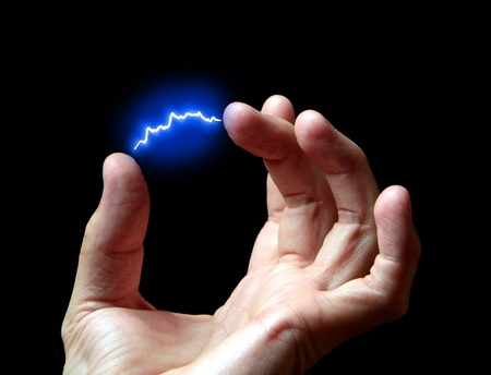 discharge: electric discharge in a hand against a dark background