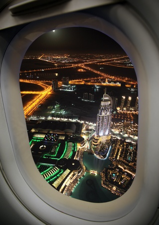 airplane window: View from the airplane window, a modern city. Stock Photo