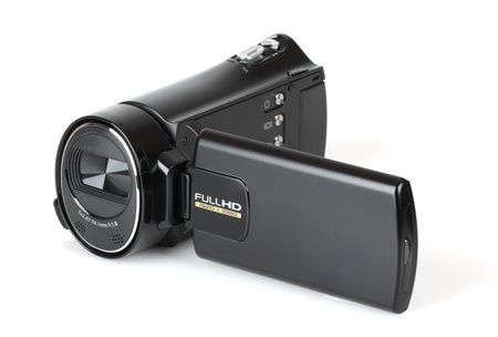 Portable video camera in black on white background. photo