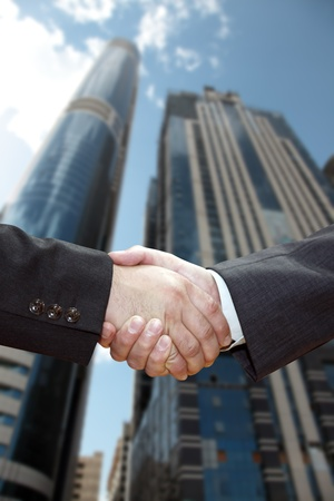 shakes hands: Handshake of business partners, against the backdrop of the city. Stock Photo