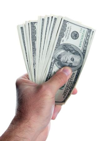 cash in hand: D�lares de los EE.UU. en la mano aisladas sobre fondo blanco