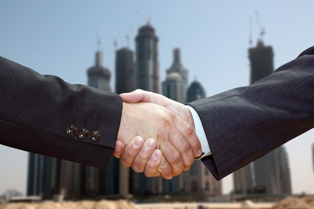 Handshake of business partners, against the backdrop of the city. Stock Photo - 11406138