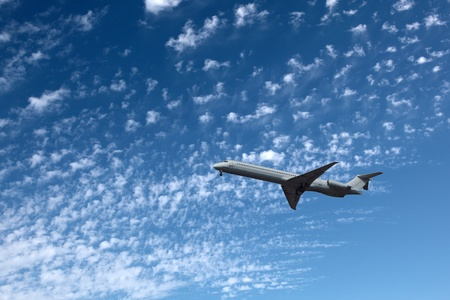 Big airliner in the blue sky with clouds. photo