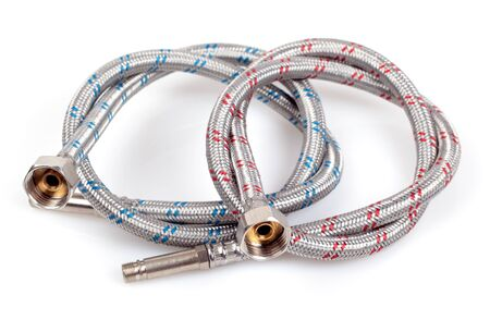 collet: Reinforced water hose isolated on white background. Stock Photo