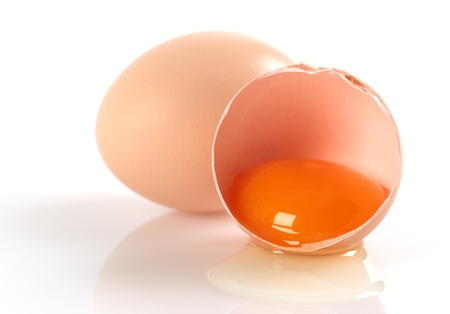 Two brown eggs on a white background.
