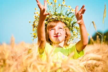 Young smiling girl in wheat field. photo