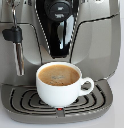 with coffee maker: Coffee machine with a cup of coffee.