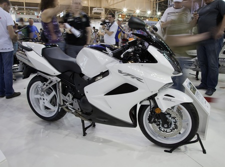 KIEV, UKRAINE - APRIL 29: A new Honda VFR800A sport motorbike is on display at the International Specialized Exhibition,