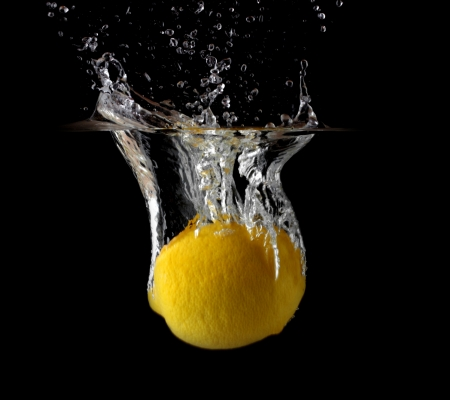 Image a lemon in water on black background. Stock Photo - 13830917