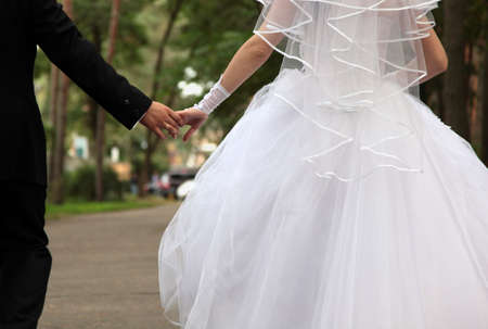 recently: Bride and groom holding hands