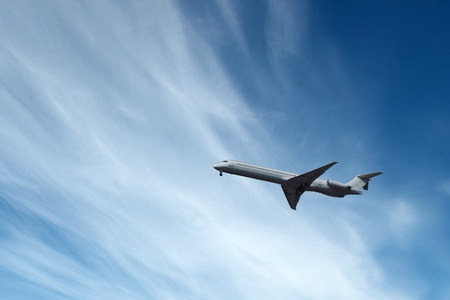 Big airliner in the blue sky with clouds Stock Photo - 16556503