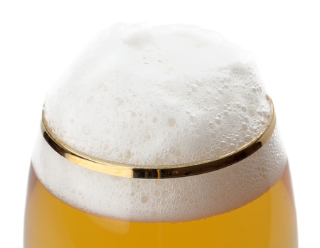 glass of beer with foam isolated on white background photo