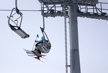 skiers: Skiers on the lift Stock Photo
