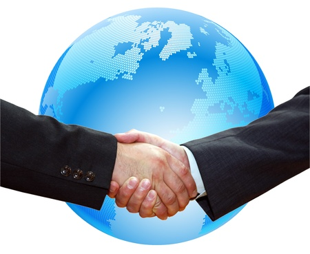 congratulating: Handshake of business partners, against the background of the Earth.