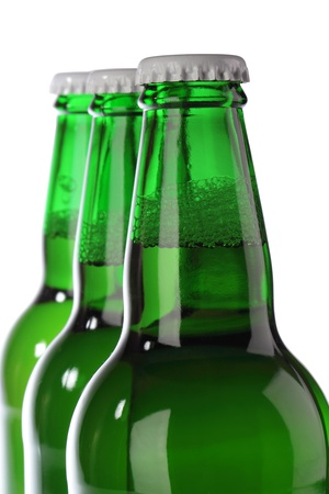 Beer bottle with drops isolated on white  photo