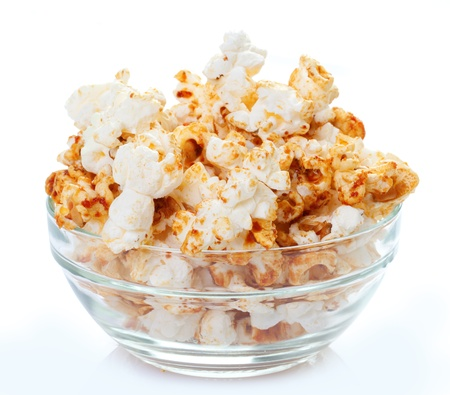 bowl of popcorn: Popcorn in a bowl isolated on white background