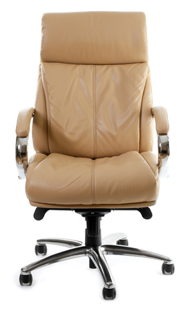 Beige leather office chair isolated on a white background. photo