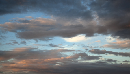 Image of a blue sky with orange clouds.  photo