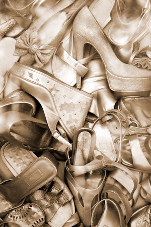 Lots of old gold color shoes. photo