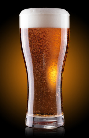glass of beer with foam photo