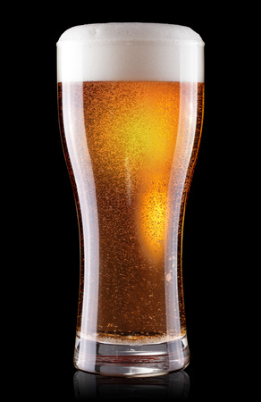 glass of beer with foam isolated on black background  photo