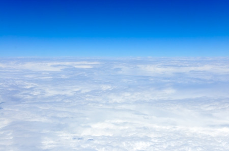 above the clouds: view of clouds from an airplane window