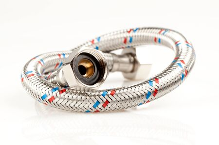collet: Reinforced water hose on white background. Stock Photo