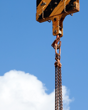 hook up: The Hook of the Elevating Crane against the blue sky, a close up Stock Photo