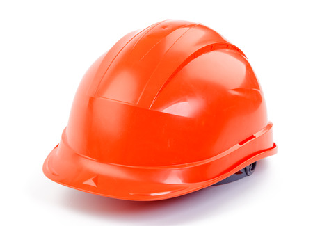 Orange plastic construction Helmet on a white background Foto de archivo