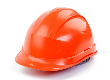 a helmet: Orange plastic construction Helmet on a white background Stock Photo