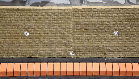 insulate: Wall of Bricks and Insulation Wool