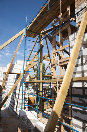 rafters: Building a new home with wooden rafters. Stock Photo