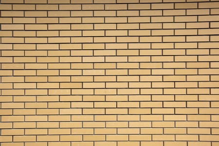 bricks background: Texture of a wall of yellow bricks. Industrial background