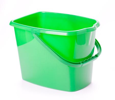 Green bucket on a white background Standard-Bild