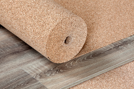 Natural cork substrate in a roll on the floor with a laminate Stock Photo - 98971254