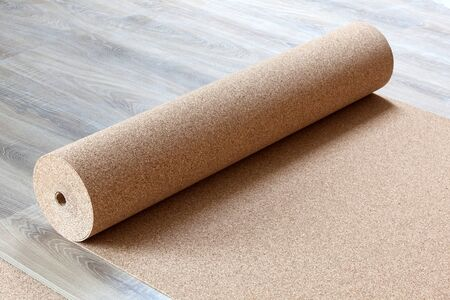 Laminate with a natural cortical substrate in a roll on the floor