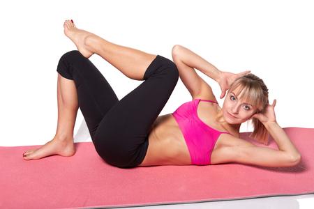studio shots: Young beautiful fitness woman stretching, studio shots