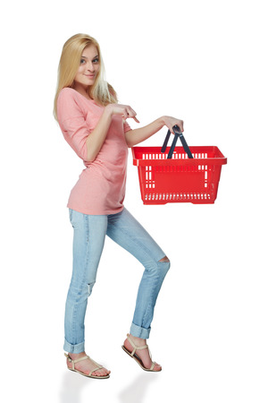 woman shopping cart: Shopping woman. Full length casual young woman standing smiling with empty shopping cart basket, over white background