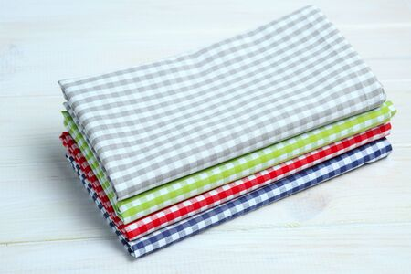 dishtowel: Multi-colored kitchen towels, on a white wooden background
