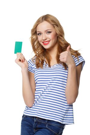 thumbup: Happy smiling girl showing blank credit card and gesturing thumb up, on white background!